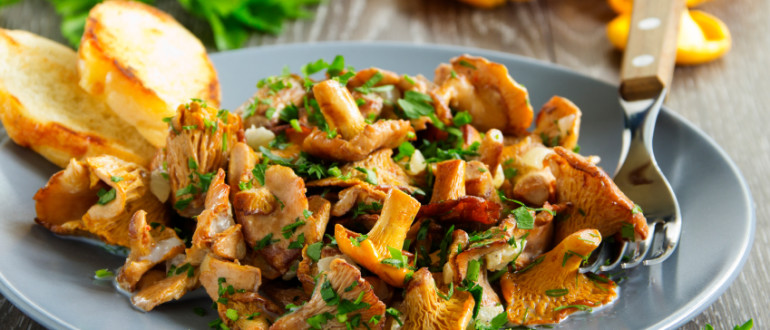 Fried chanterelle mushrooms in a creamy sauce